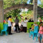 Kapolres Pohuwato Kunjungi Tempat Vaksinasi Massal di Desa Sari Murni Kecamatan Randangan